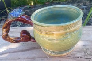 Whimsical & Nature Themed, this cup was a commission piece by an art lover  looking for an organic style handle.